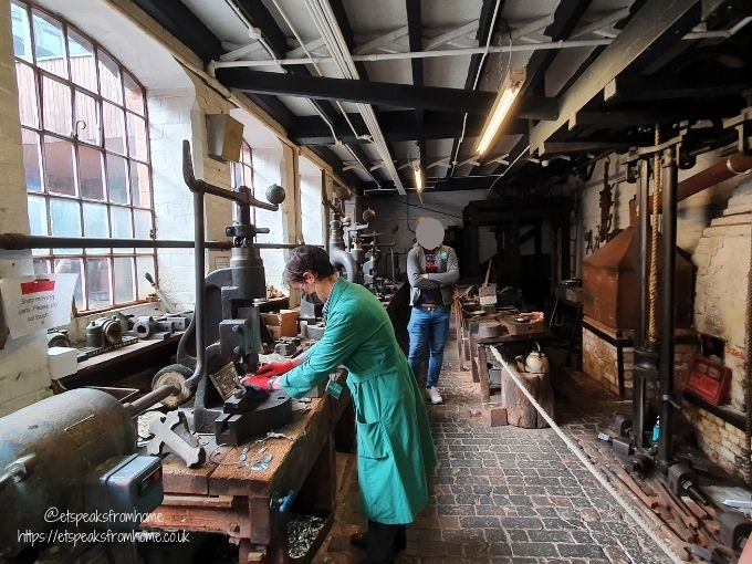 the coffin works stamping machine