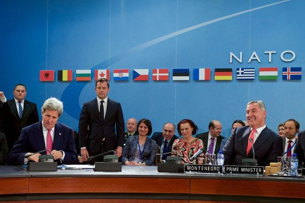Milo Djukanovic and Seceratry John Kerry signing NATO agreement
