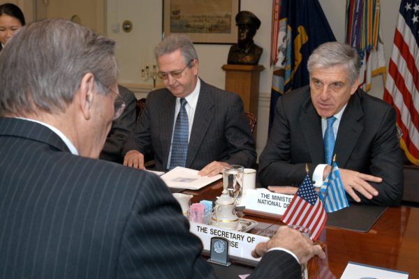 Greek Minister of National Defense Yannos Papantoniou (right) meets with Secretary of Defense Donald H. Rumsfeld (foreground) in the Pentagon on April 1, 2003.