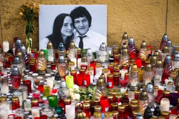 Hundreds of candles have been placed in front of a portrait of Jan Kuciak and his fiancée Martina Kušnírová in Bratislava, Slovakia.