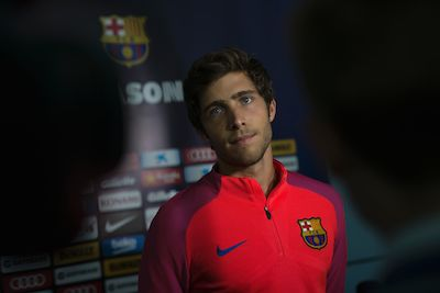Barcelona's Spanish midfielder Sergi Roberto is interviewed by members of the media following a team training session at St George's Park near Burton-on-Trent, central England, on July 29, 2016.