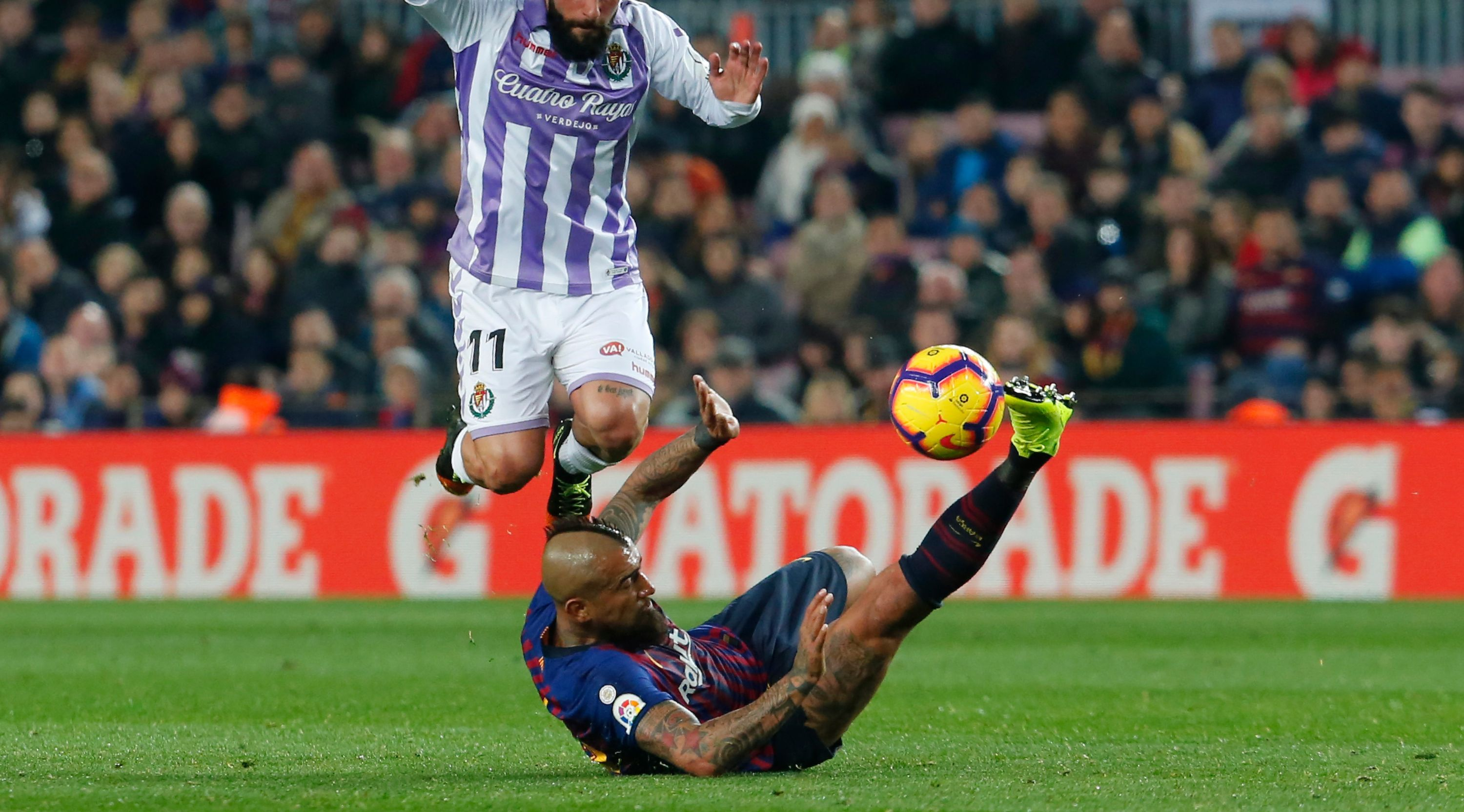 Real Valladolid's Italian midfielder Daniele Verde (L) vies for the ball with Barcelona's Chilean midfielder Arturo Vidal during the Spanish League football match between Barcelona and Real Valladolid at the Camp Nou stadium in Barcelona on February 16, 2019. (Photo by Pau Barrena / AFP) (Photo credit should read PAU BARRENA/AFP/Getty Images)