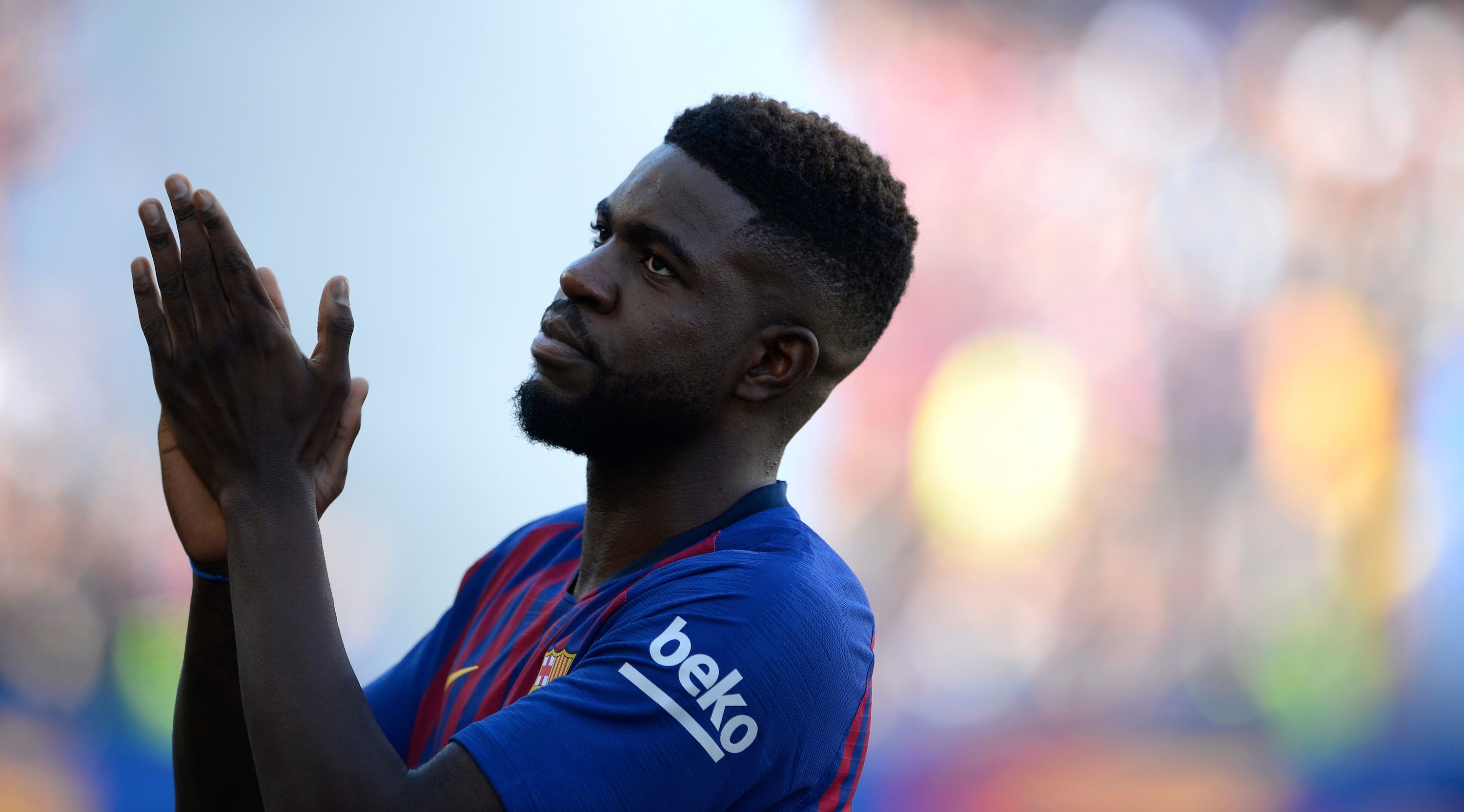 Barcelona's French defender Samuel Umtiti acknowledges fans before the 53rd Joan Gamper Trophy friendly football match between Barcelona and Boca Juniors at the Camp Nou stadium in Barcelona on August 15, 2018. (Photo by Josep LAGO / AFP) (Photo credit should read JOSEP LAGO/AFP/Getty Images)