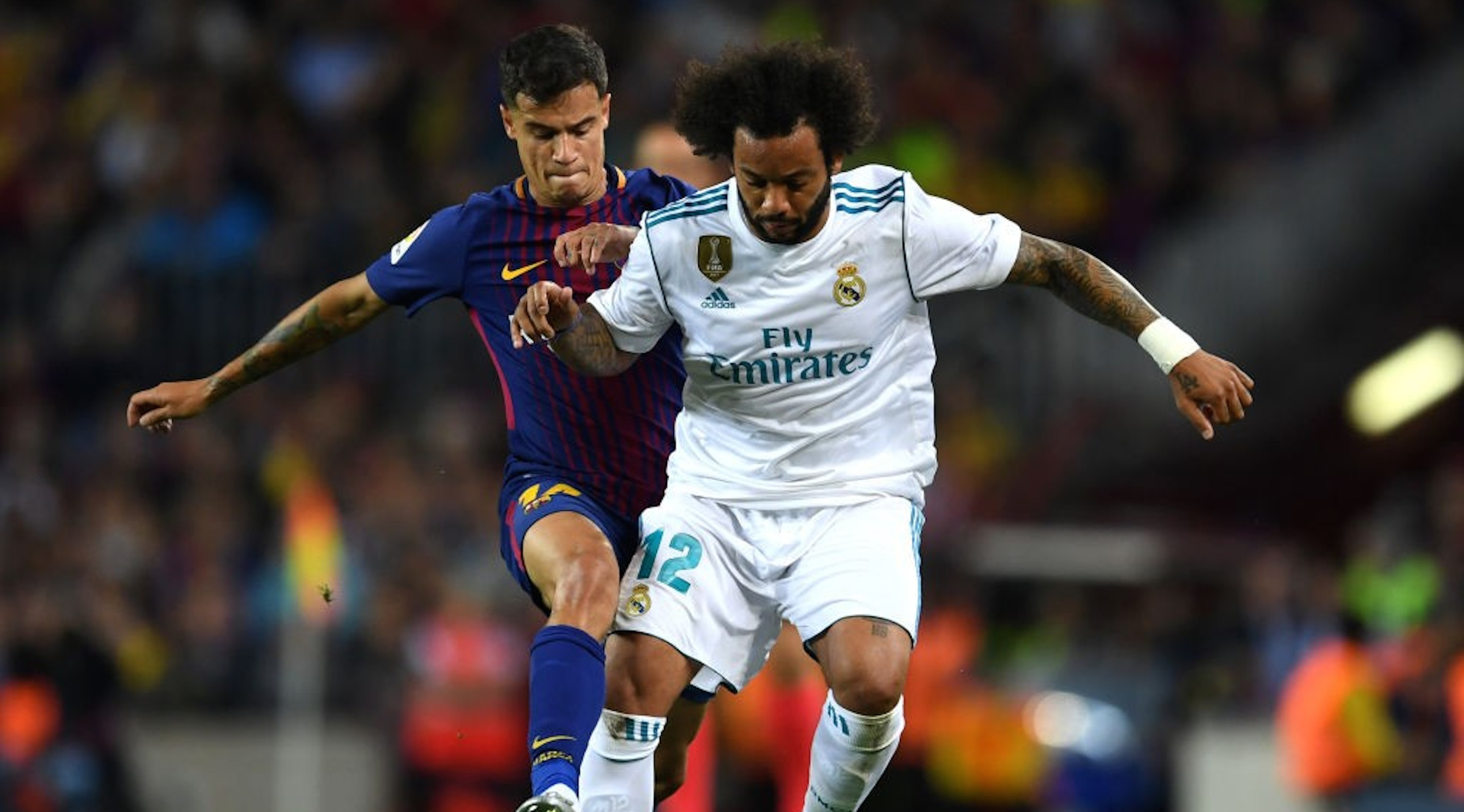 BARCELONA, SPAIN - MAY 06: Marcelo of Real Madrid battles with Philippe Coutinho of Barcelona during the La Liga match between Barcelona and Real Madrid at Camp Nou on May 6, 2018 in Barcelona, Spain. (Photo by David Ramos/Getty Images)