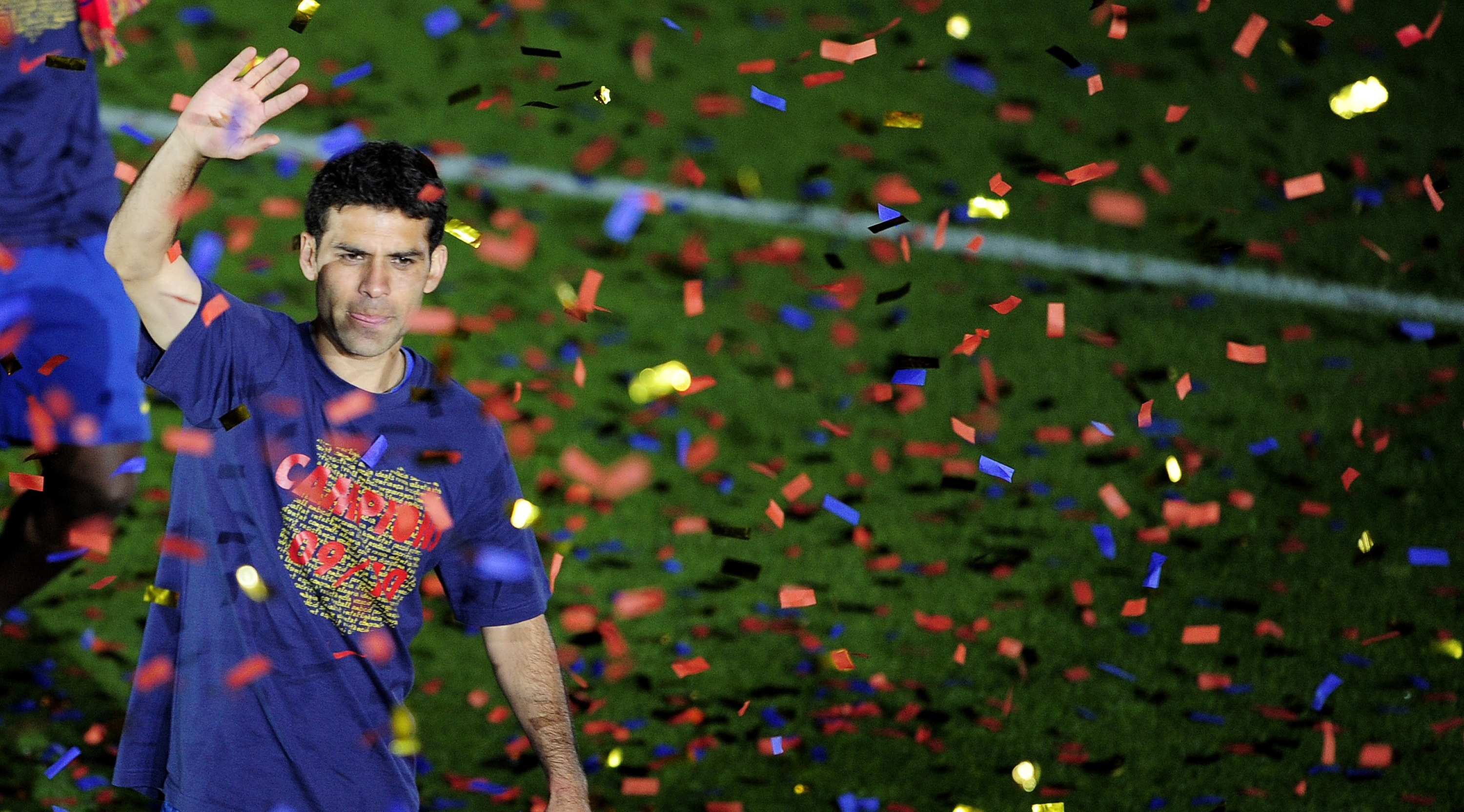 Barcelona's Mexican defender Rafa Marquez celebrates after winning the Spanish La Liga title at Camp Nou stadium in Barcelona on May 16, 2010. Barcelona retained the Spanish La Liga title on the final day of the 2009/10 season with a 4-0 win over Valladolid at Camp Nou on Sunday to finish above arch rivals Real Madrid. AFP PHOTO / JOSEP LAGO (Photo credit should read JOSEP LAGO/AFP/Getty Images)