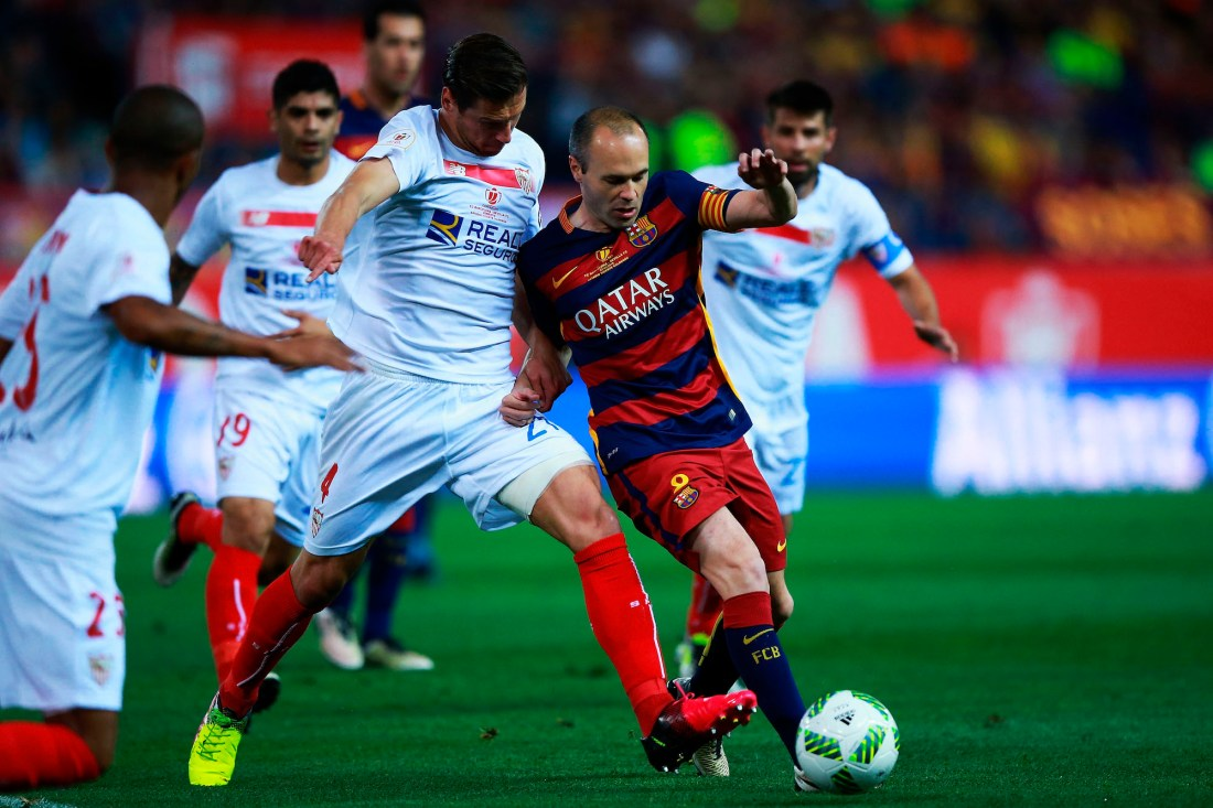 MADRID, SPAIN - MAY 22: Andres Iniesta (R) of FC Barcelona competes for the ball with Grzegorz Krychowiak (L) of Sevilla FC during the Copa del Rey Final match between FC Barcelona and Sevilla FC at Vicente Calderon Stadium on May 22, 2016 in Madrid, Spain. (Photo by Gonzalo Arroyo Moreno/Getty Images)