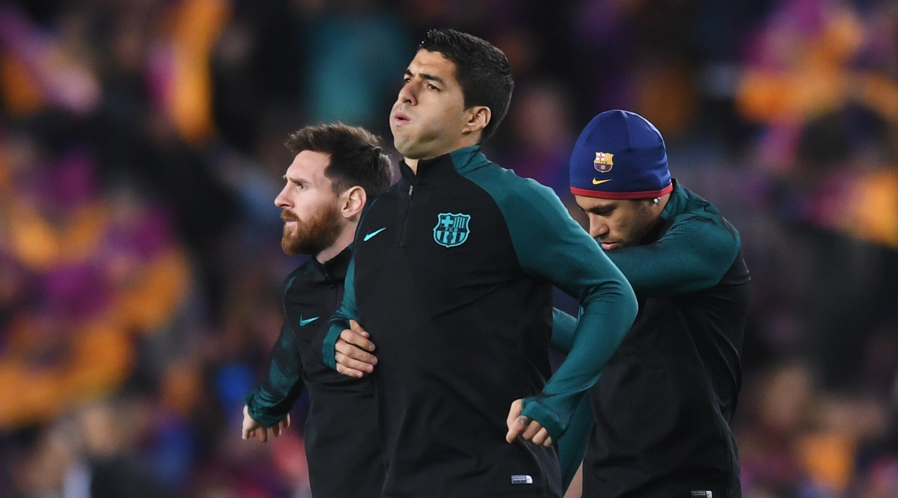 BARCELONA, SPAIN - MARCH 08: Lionel Messi, Luis Suarez and Neymar of Barcelona warm up prior to the UEFA Champions League Round of 16 second leg match between FC Barcelona and Paris Saint-Germain at Camp Nou on March 8, 2017 in Barcelona, Spain. (Photo by Michael Regan/Getty Images)