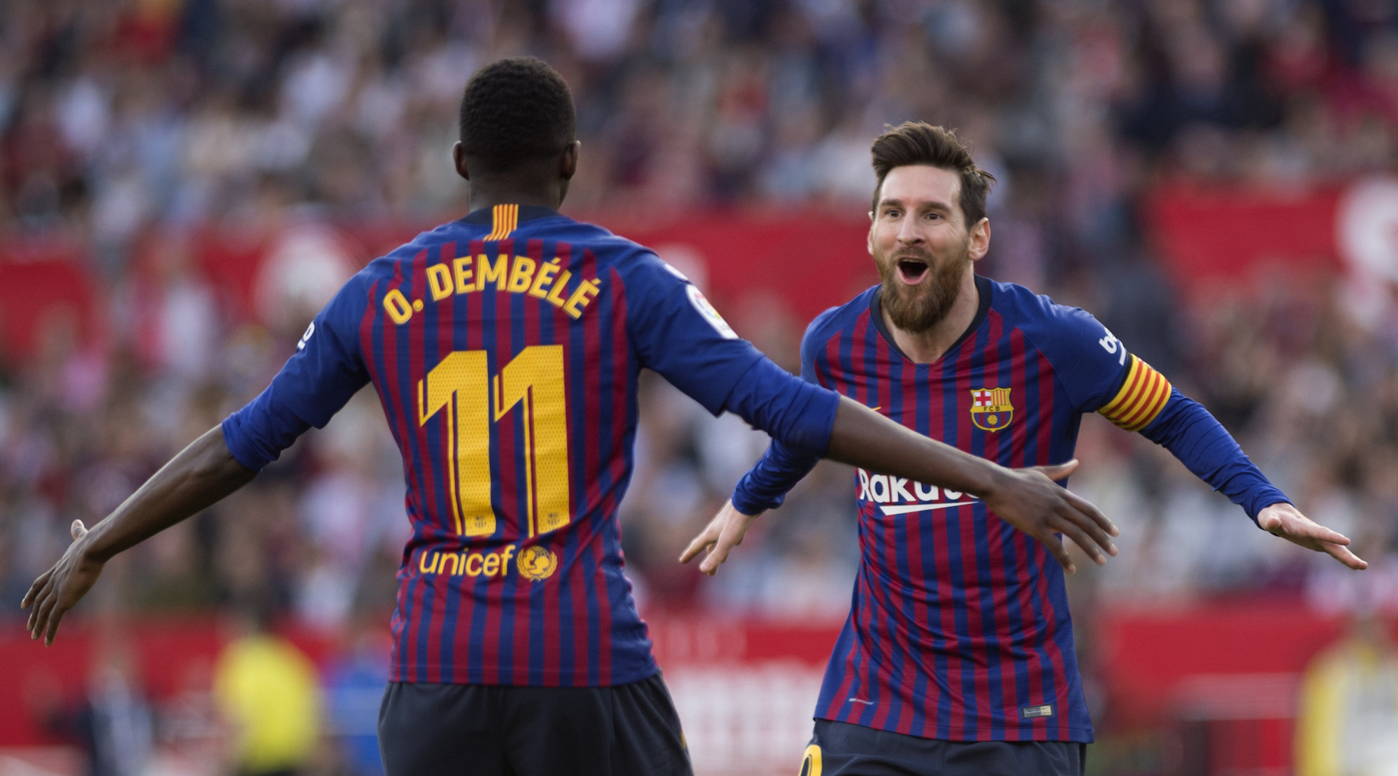 Barcelona's Argentinian forward Lionel Messi (R) celebrates with Barcelona's French forward Ousmane Dembele after scoring a goal during the Spanish league football match between Sevilla FC and FC Barcelona at the Ramon Sanchez Pizjuan stadium in Sevilla on February 23, 2019. (Photo by JORGE GUERRERO / AFP) (Photo credit should read JORGE GUERRERO/AFP/Getty Images)