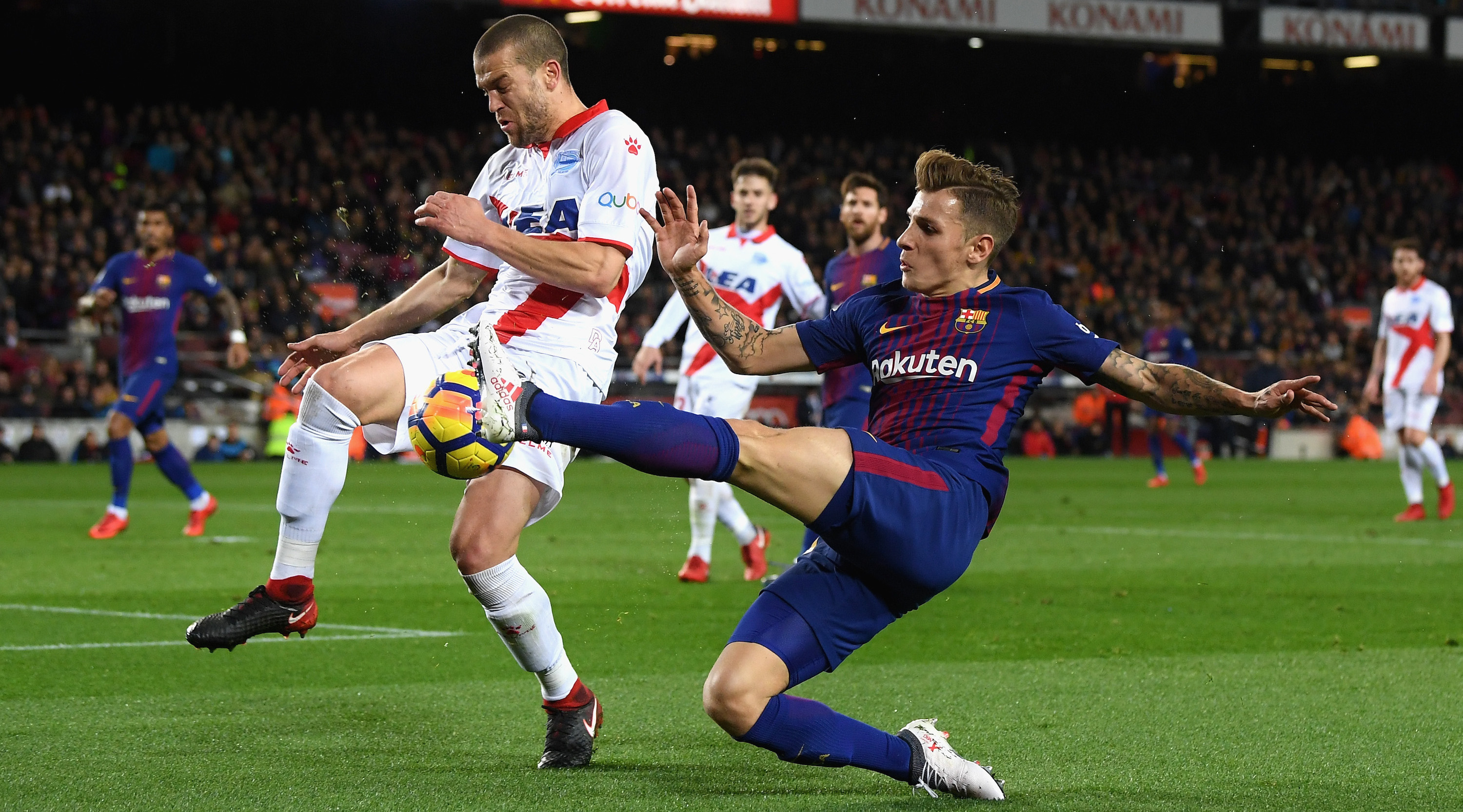 BARCELONA, SPAIN - JANUARY 28: Lucas Digne of Barcelona battles for posession with Víctor Laguardia of Alaves during the La Liga match between Barcelona and Deportivo Alaves at Camp Nou on January 28, 2018 in Barcelona, Spain. (Photo by David Ramos/Getty Images)