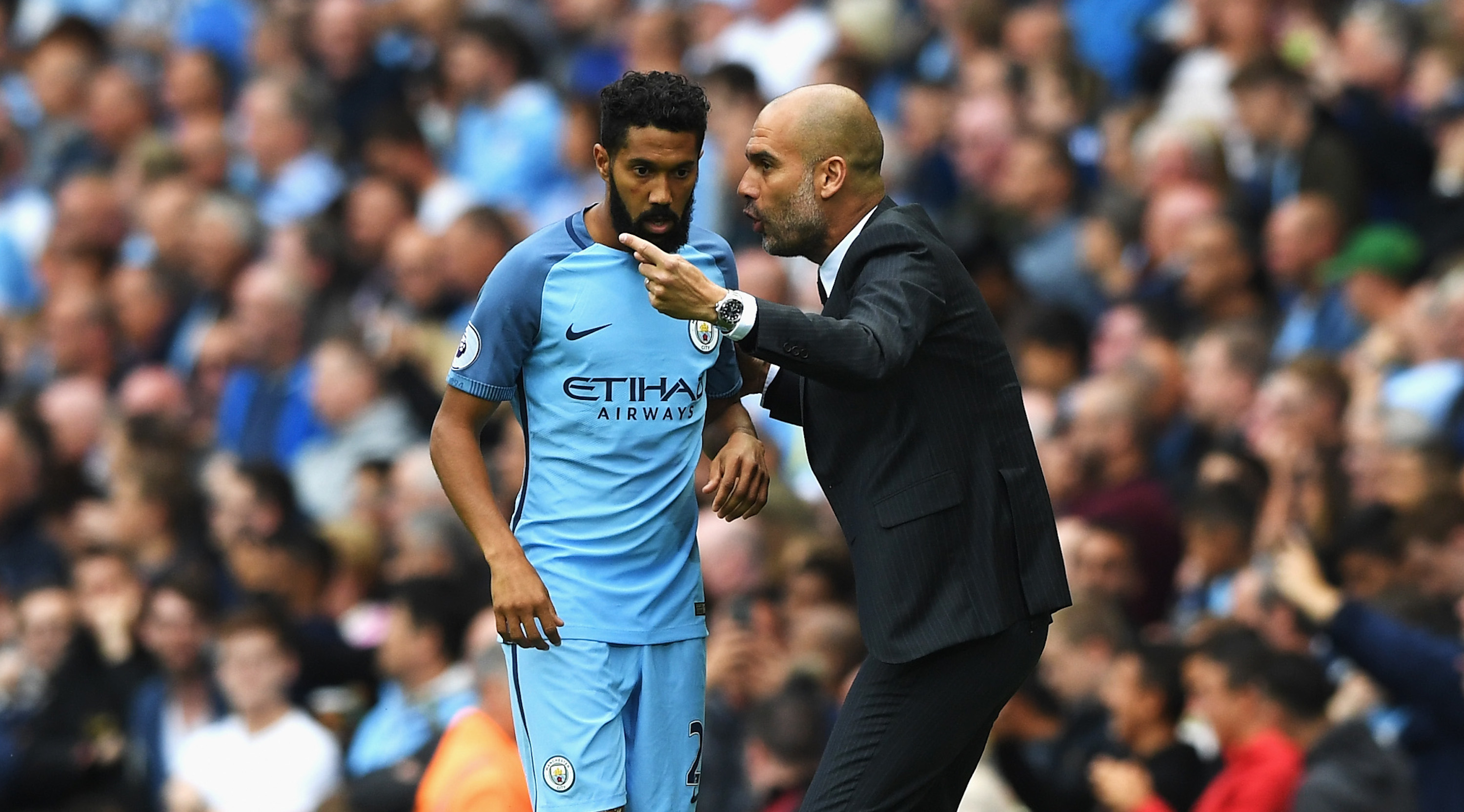 MANCHESTER, ENGLAND - AUGUST 13: Gael Clichy of Manchester City gets instructins from Josep Guardiola, Manager of Manchester City during the Premier League match between Manchester City and Sunderland at Etihad Stadium on August 13, 2016 in Manchester, England. (Photo by Stu Forster/Getty Images)