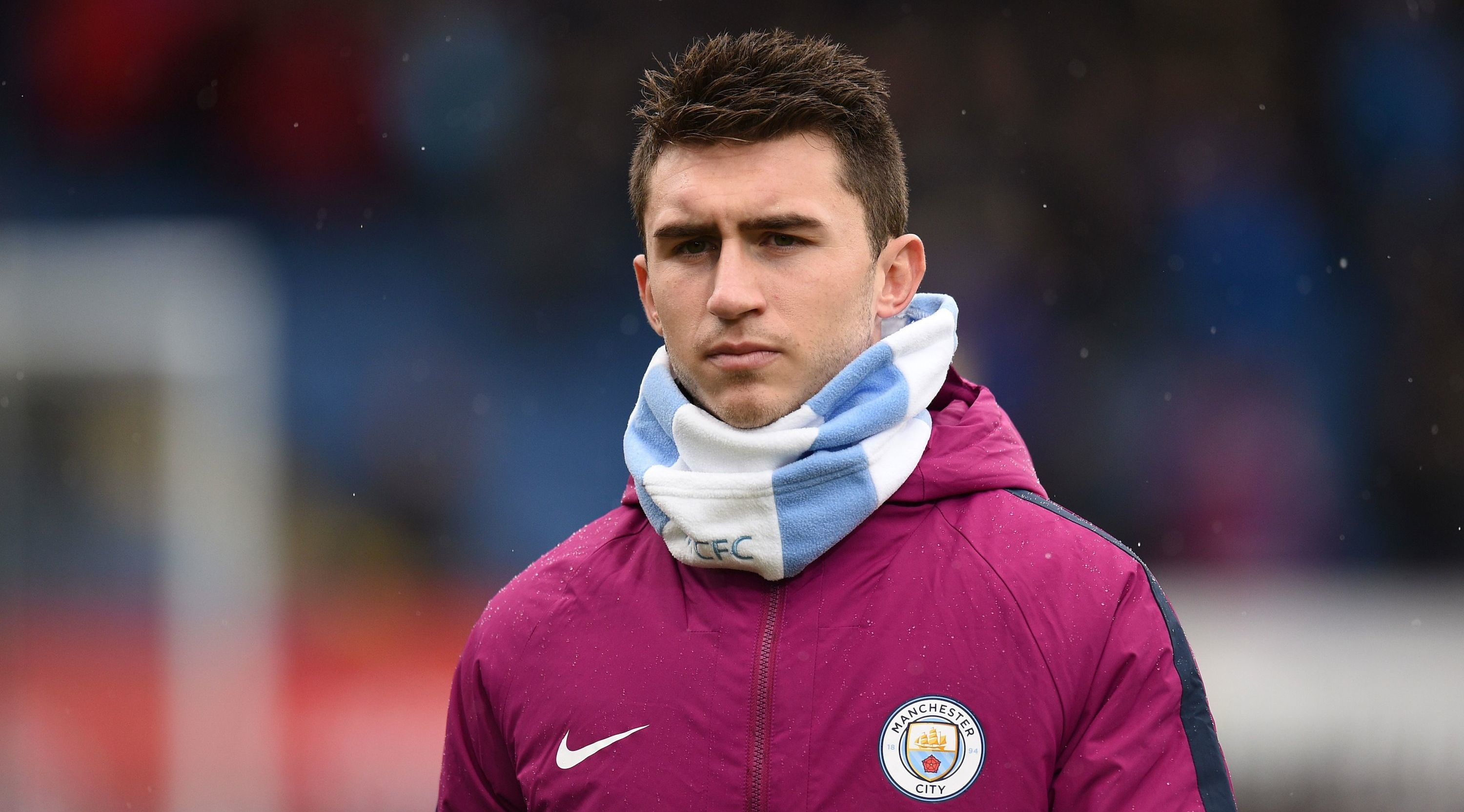 Manchester City's French defender Aymeric Laporte warms up for the English Premier League football match between Burnley and Manchester City at Turf Moor in Burnley, north west England on February 3, 2018. / AFP PHOTO / Oli SCARFF / RESTRICTED TO EDITORIAL USE. No use with unauthorized audio, video, data, fixture lists, club/league logos or 'live' services. Online in-match use limited to 75 images, no video emulation. No use in betting, games or single club/league/player publications. / (Photo credit should read OLI SCARFF/AFP/Getty Images)