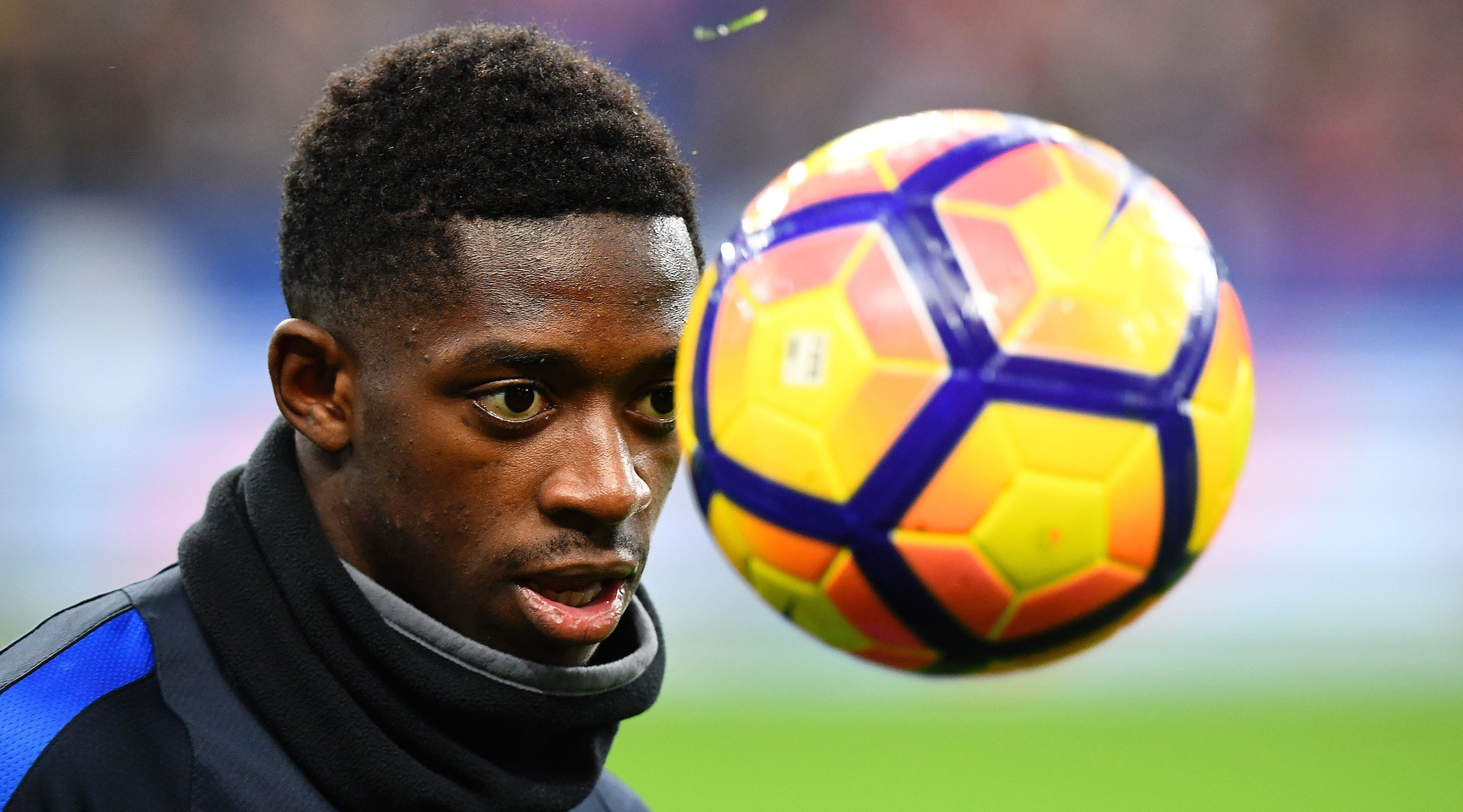 France's forward Ousmane Dembele eyes the ball during the 2018 World Cup group A qualifying football match between France and Sweden at the Stade de France in Saint-Denis, north of Paris, on November 11, 2016. France won 2-1. / AFP / FRANCK FIFE (Photo credit should read FRANCK FIFE/AFP/Getty Images)