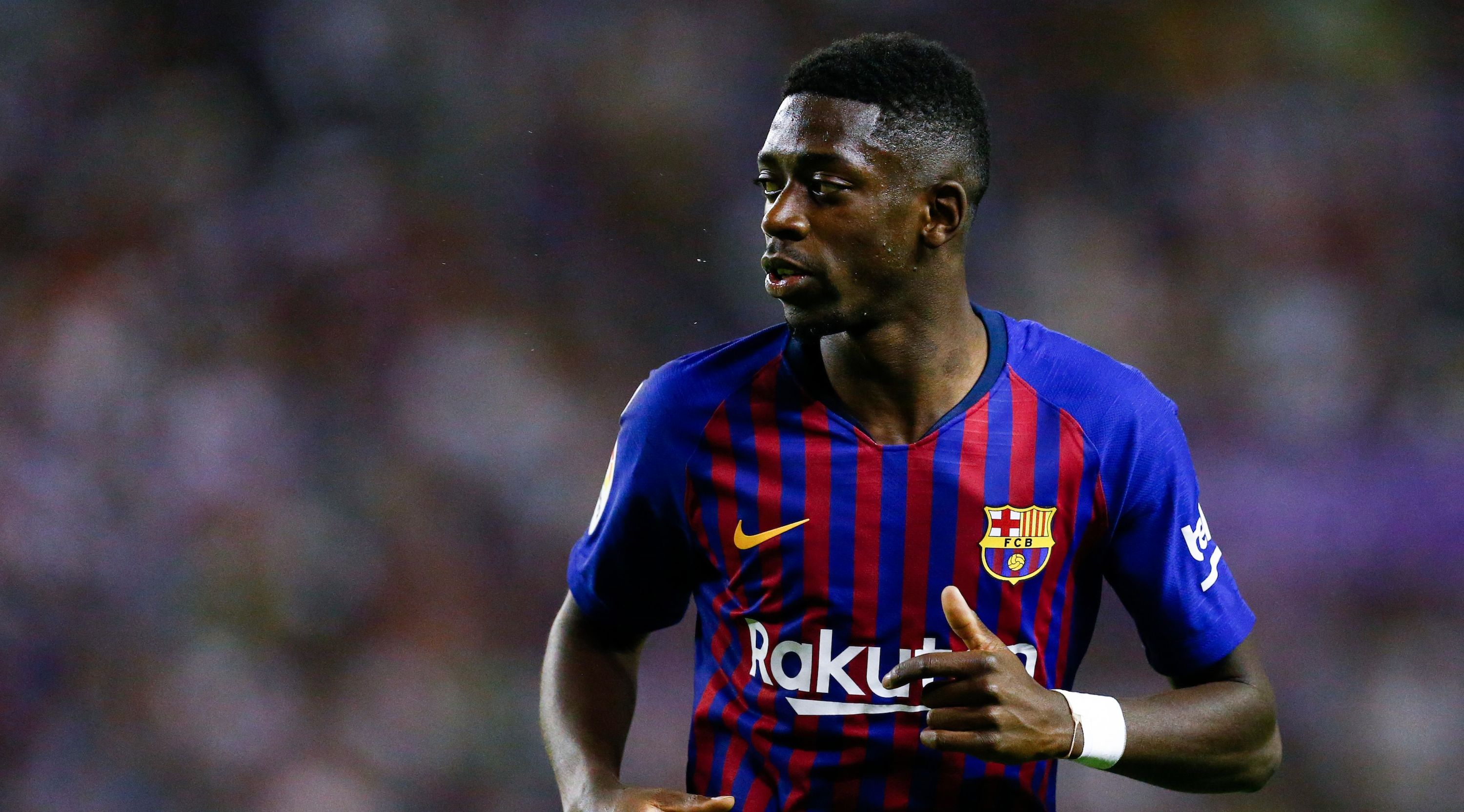 Barcelona's French forward Ousmane Dembele runs during the Spanish league football match between Real Valladolid and FC Barcelona at the Jose Zorrilla Stadium in Valladolid on August 25, 2018. (Photo by Benjamin CREMEL / AFP) (Photo credit should read BENJAMIN CREMEL/AFP/Getty Images)