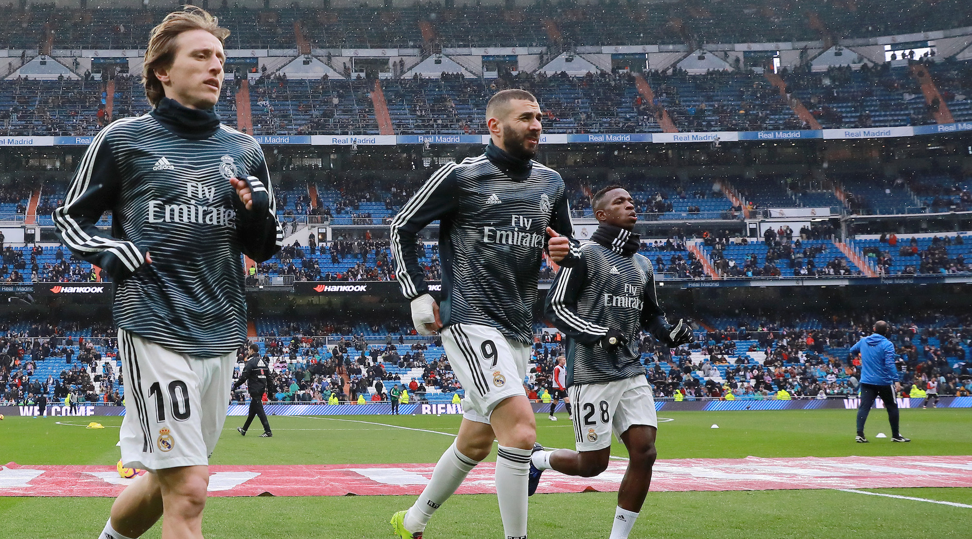 Luka Modric, Karim Benzema and Vinicius Junior of Real Madrid leave the pitch following a warm up prior to the La Liga match between Real Madrid CF and Sevilla FC at Estadio Santiago Bernabeu on January 19, 2019 in Madrid, Spain. (Photo by Gonzalo Arroyo Moreno/Getty Images)
