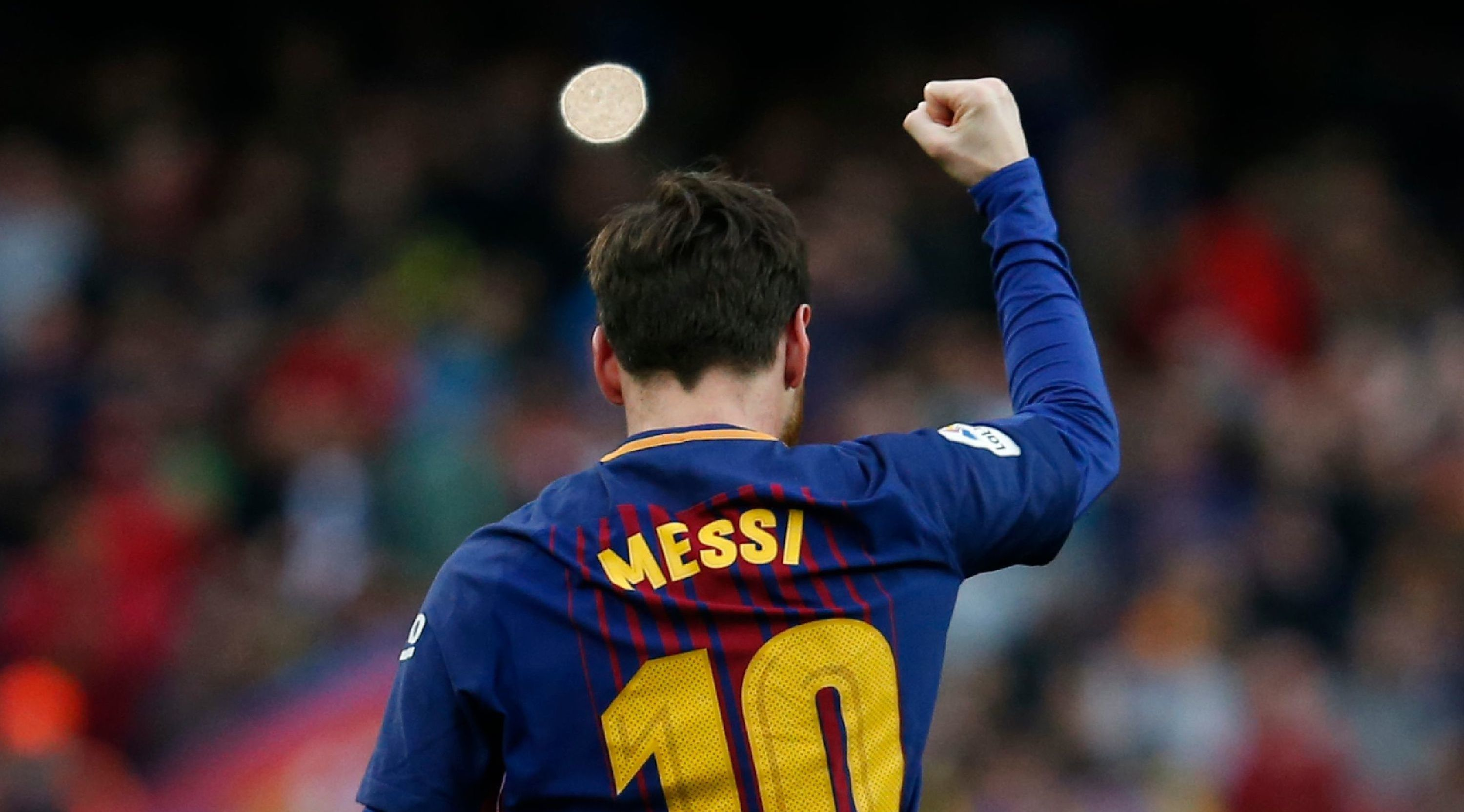 Barcelona's Argentinian forward Lionel Messi celebrates after scoring during the Spanish league football match FC Barcelona against Club Atletico de Madrid at the Camp Nou stadium in Barcelona on March 04, 2018. / AFP PHOTO / Pau Barrena (Photo credit should read PAU BARRENA/AFP/Getty Images)