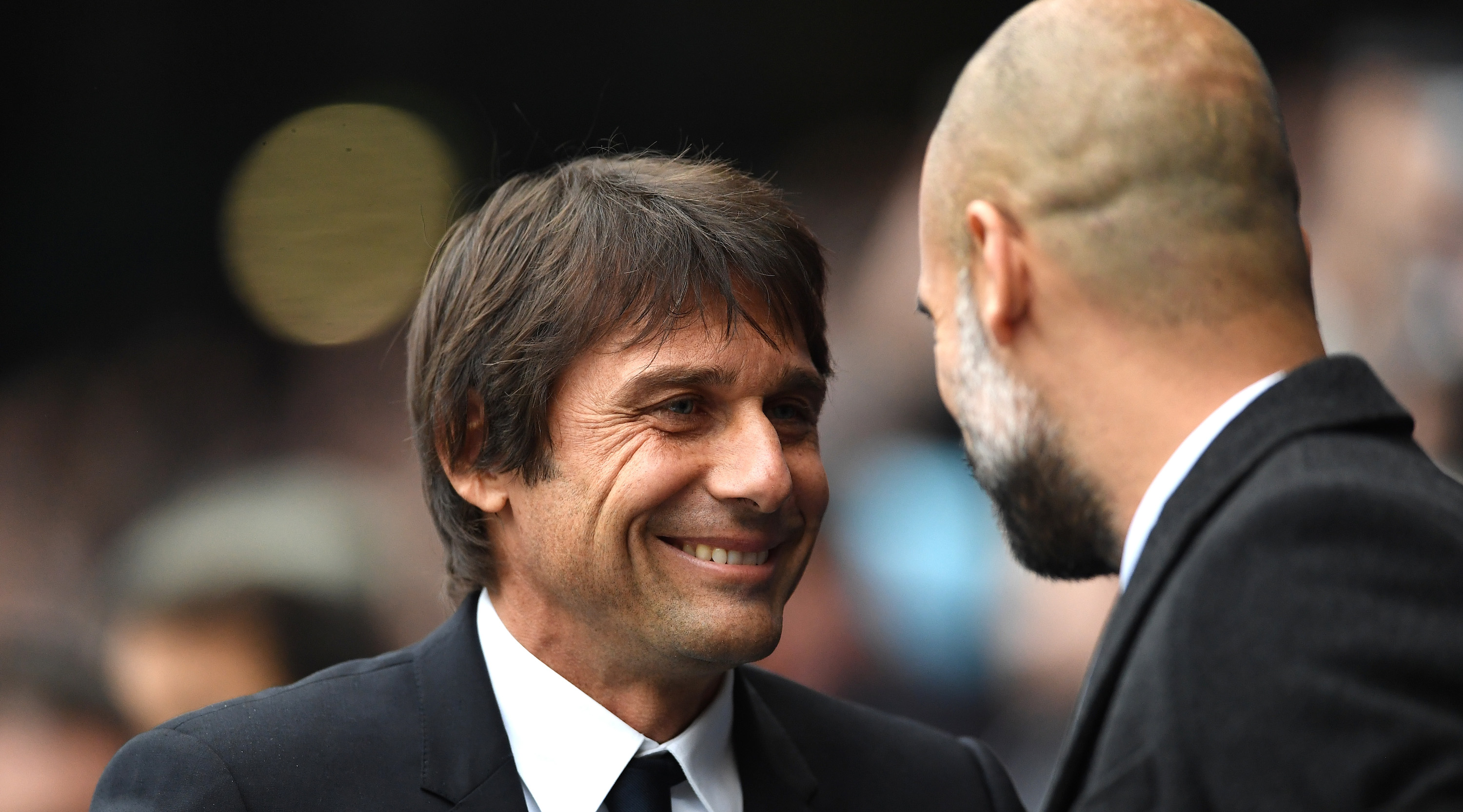 MANCHESTER, ENGLAND - DECEMBER 03: Antonio Conte, Manager of Chelsea and Josep Guardiola, Manager of Manchester City greet prior to the Premier League match between Manchester City and Chelsea at Etihad Stadium on December 3, 2016 in Manchester, England. (Photo by Laurence Griffiths/Getty Images)