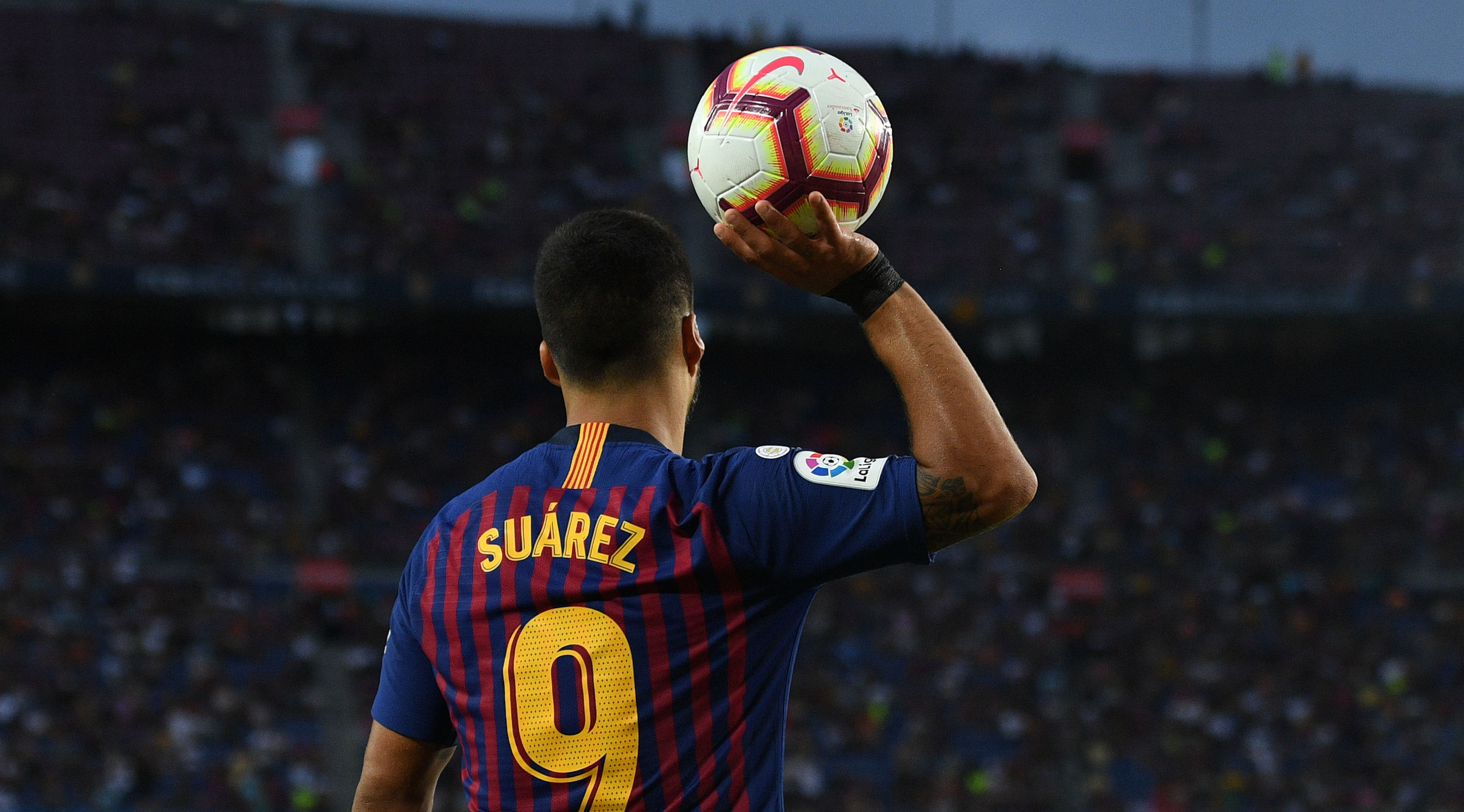 Luis Suarez of FC Barcelona grabs the ball during the La Liga match between FC Barcelona and SD Huesca at Camp Nou on September 2, 2018 in Barcelona, Spain. (Photo by David Ramos/Getty Images)