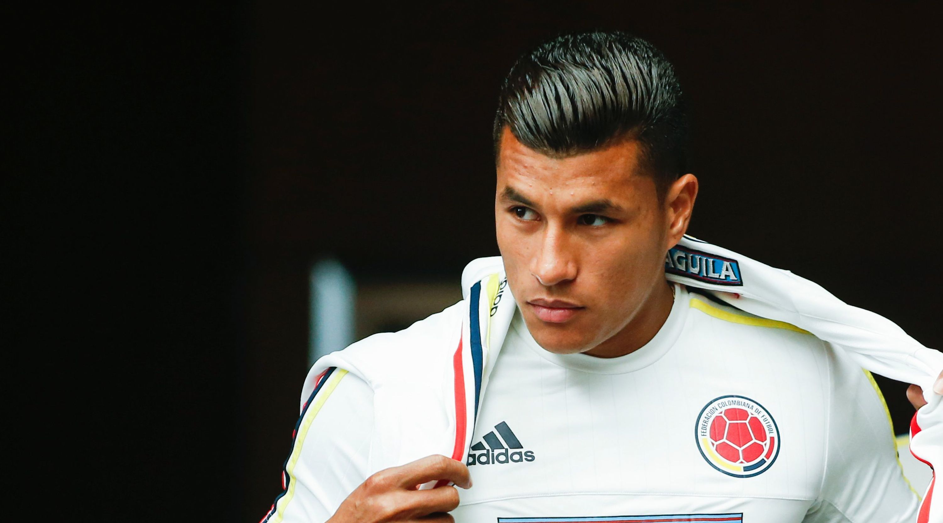 Colombia's players Jeison Murillo (L) and Sebastian Perez arrive for a press conference in Hoboken, New Jersey, on June 15, 2016. Colombia will face Peru on June 17 in their Quarter-finals match of the Copa America. / AFP / EDUARDO MUNOZ ALVAREZ (Photo credit should read EDUARDO MUNOZ ALVAREZ/AFP/Getty Images)
