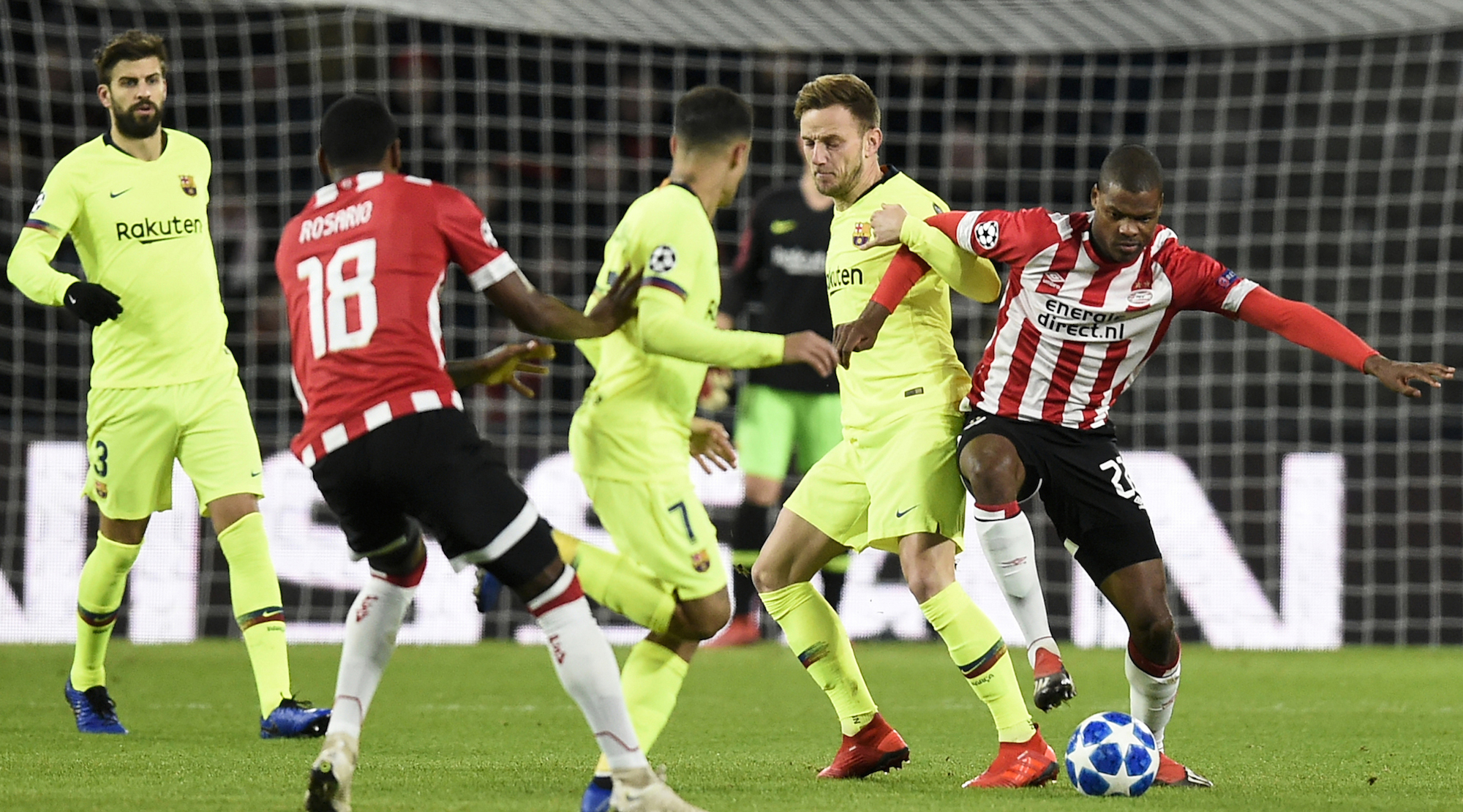 Barcelona's Crotian midfielder Ivan Rakitic (2ndR) vies with Eindhoven's midfielder Ramon Pascal Lundqvist (R) during the UEFA Champions League football match between PSV Eindhoven and FC Barcelona at Philips stadium in Eindhoven on November 28, 2018. (Photo by JOHN THYS / AFP) (Photo credit should read JOHN THYS/AFP/Getty Images)