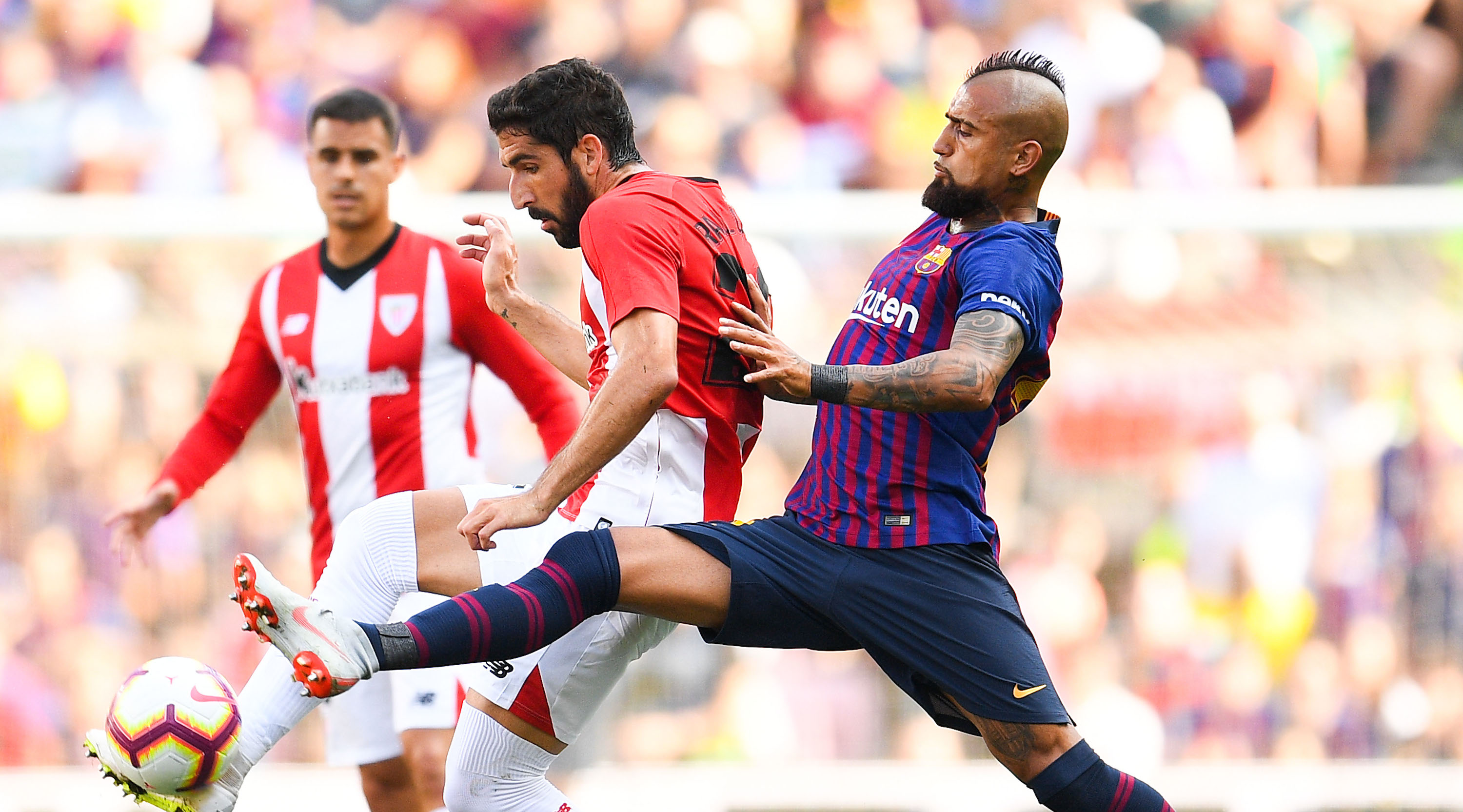 BARCELONA, SPAIN - SEPTEMBER 29: Arturo Vidal of FC Barcelona competes for the ball with Raul Garcia of Athletic Club during the La Liga match between FC Barcelona and Athletic Club at Camp Nou on September 29, 2018 in Barcelona, Spain. (Photo by David Ramos/Getty Images)