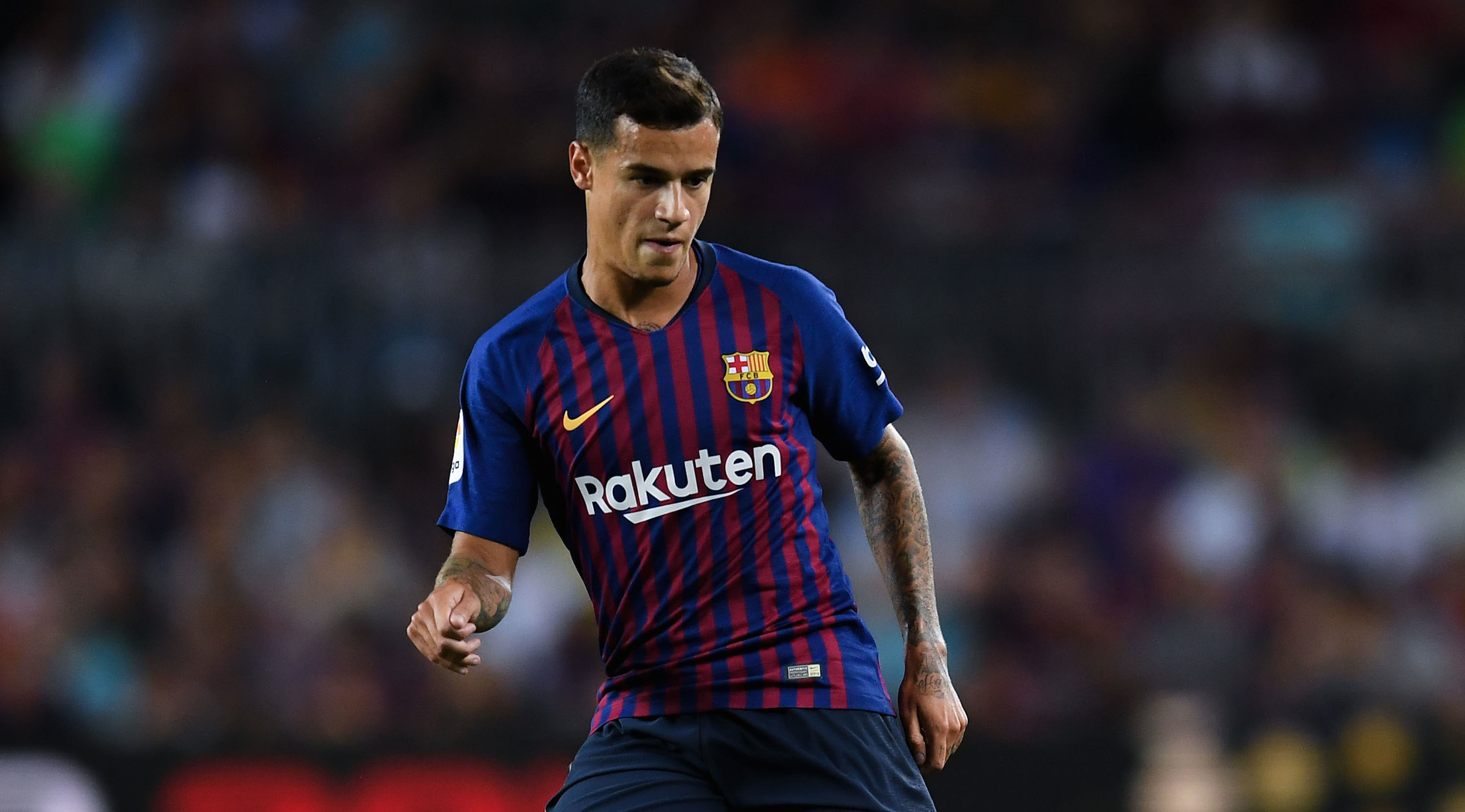 BARCELONA, SPAIN - AUGUST 18: Philippe Coutinho of FC Barcelona runs with the ball during the La Liga match between FC Barcelona and Deportivo Alaves at Camp Nou on August 18, 2018 in Barcelona, Spain. (Photo by David Ramos/Getty Images)