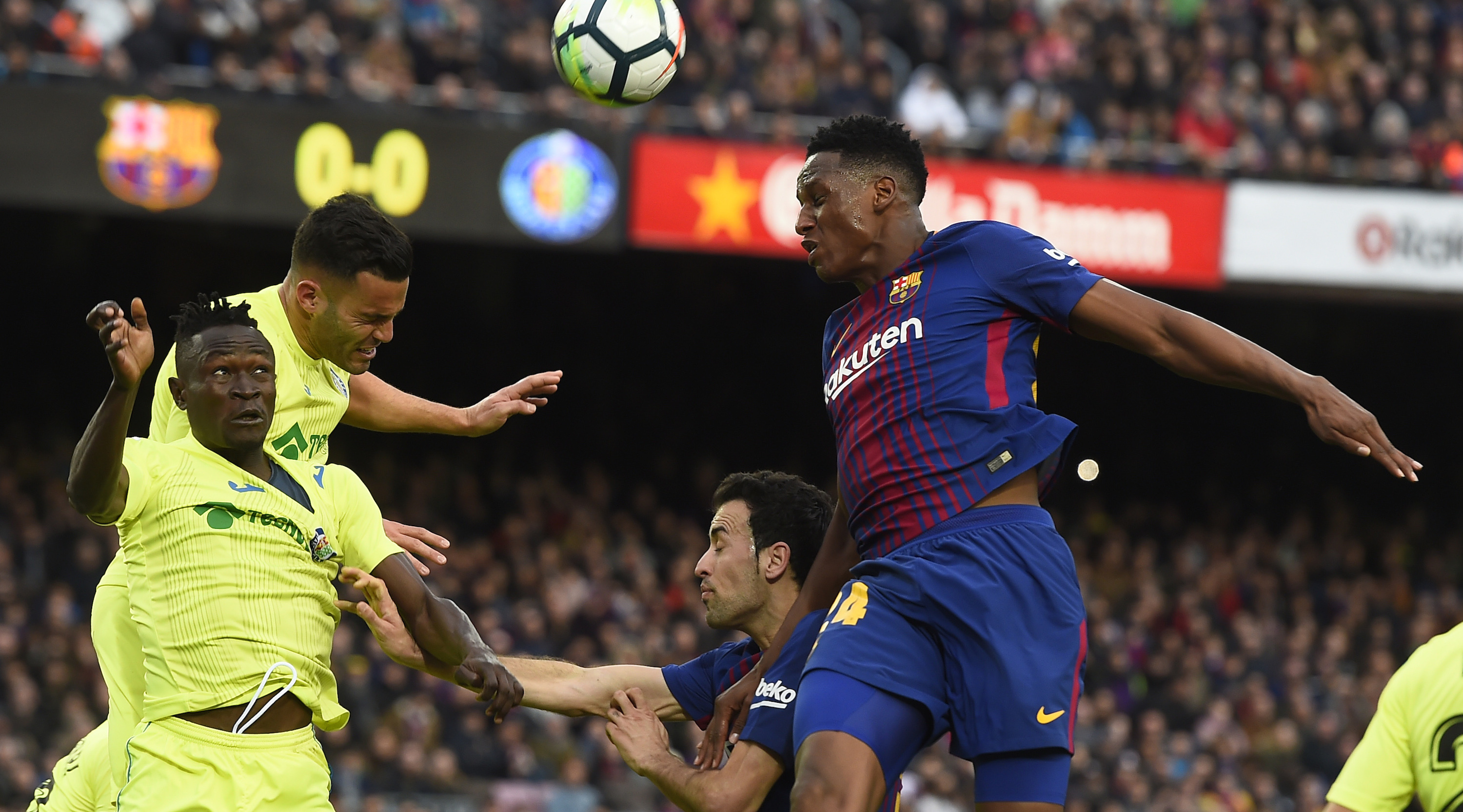 Getafe's Togolese defender Dakonam Djene (L) vies with Barcelona's Colombian defender Yerry Mina (R) during the Spanish league football match between FC Barcelona and Getafe CF at the Camp Nou stadium in Barcelona on February 11, 2018. / AFP PHOTO / Josep LAGO (Photo credit should read JOSEP LAGO/AFP/Getty Images)