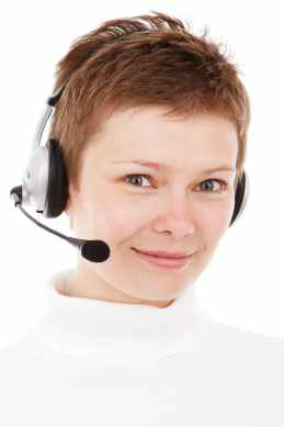 person wearing silver headset smiling