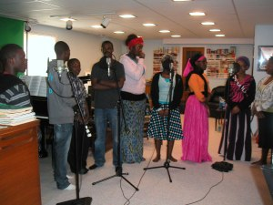 The Amen Choir waiting between choruses to sing.