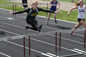 Sophomore Cody Gibbs clears the hurdle in the 100 meter hurdles.