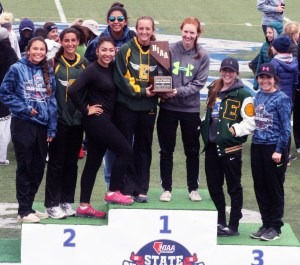 The girls team accepting their runner up trophy from left: Angelika Townsend, Alia Minoletti, Jiselle Dominquez, Angel Greely, Elsie Etchegaray, Megan Damele, Cody Gibbs, and Katie Damele.