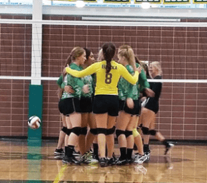 Ally Protani - The Lady Vandals huddle up during their sweep of visiting Carlin on Homecoming night Friday.
