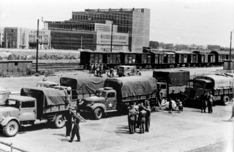 US troops at Wolfsburg railway station with the Volkswagen power plant in the background.