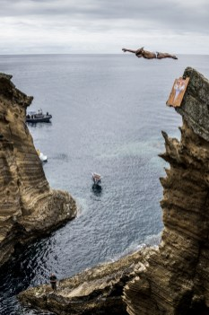 Todor Spasov of Bulgaria dives 21 metres at the Whales Kitchen on Islet Franca do Campo during the first training session of the second stop of the Red Bull Cliff Diving World Series at Sao Miguel, Azores, Portugal on July 7th 2017. // Dean Treml/Red Bull Content Pool // AP-1SHNATGE92111 // Usage for editorial use only //