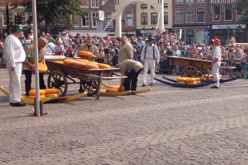 Cheese is loaded onto carts for transport in today's Kaasmarkt
