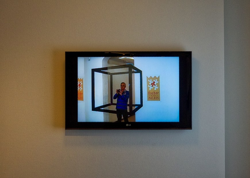 In the TV screen across the room, you can see Ian taking a photo of the TV screen across the room - from inside an Escher cage.