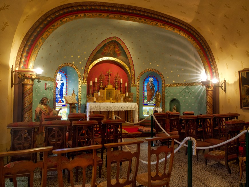 A strikingly coloured and decorated private chapel.
