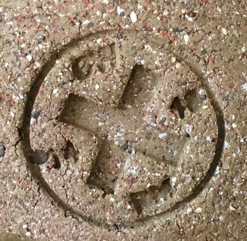 The symbol each figurine bears 19 14 and CW RM around the cross.