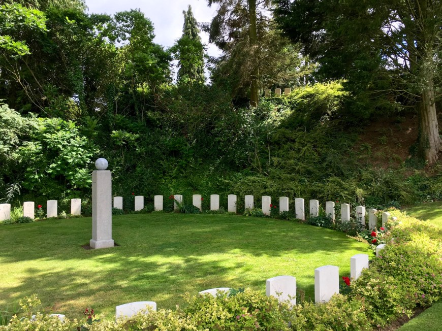 The graves are arranged in small clusters in varied settings, enhancing the 'garden' atmosphere. In contrast to the stark, regimented arrays of graves in most other war cemeteries.