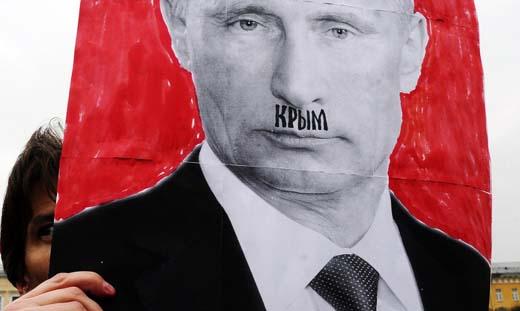 "A portrait of Putin with ""Crimea"" written on the upper lip"