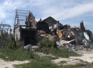 A house in Donbas destroyed by Russian artillery fire (Image: YouTube screengrab)