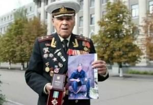 Ivan Zaluzhnyi, retired Colonel, with his grandson's posthumous award.