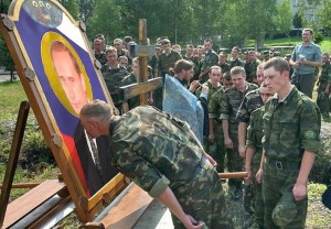 "Russian soldiers line up near the border of Ukraine to kiss an ""icon"" of Putin. Summer 2014 (Image: Social media)"
