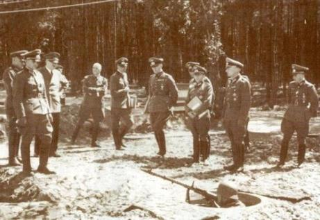 Hitler with German officers at the Werwolf, a German military HQ located outside Vinnytsia. It was the easternmost of his HQs and was built by using Ukrainians and Soviet POWs as forced labour. After its completion, those who built it were executed to protect the bunkers secrecy. It was destroyed in March 1944 to prevent it being used by the approaching Red Army.