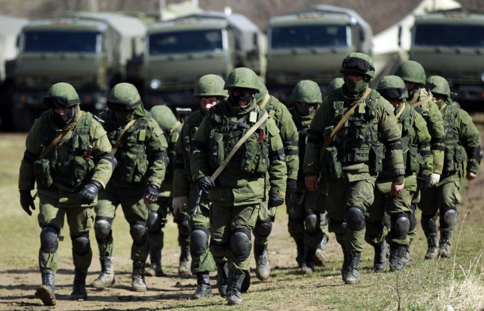 "So-called ""little green men"" (the Russian occupation troops comprised of special forces who removed insignia, wear face masks to prevent identification and call themselves a ""Crimean self-defense force"") surround a Ukrainian military base in Perevalne, Crimea, during the Russian annexation of the peninsula in February-March 2014."