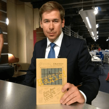 Ilya Novikov with a copy of Nadiya's book