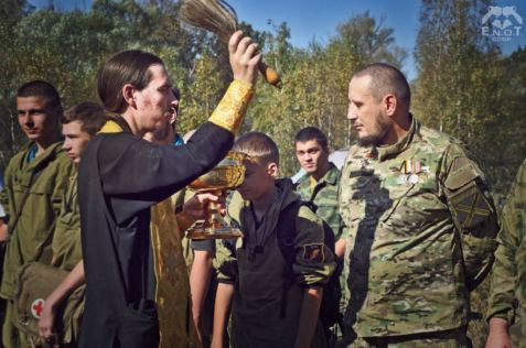 """The instructors and trainees of the mercenary camp were """"blessed"""" by a Russian Orthodox monk from the monastery in whose territory the camp is located. Moscow oblast, Russia, September 2015 (Image: ENOT Corp)"""