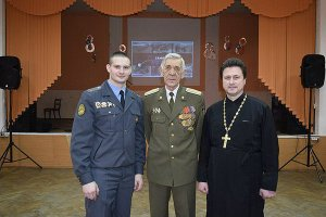 "Police Leutenant Mishkel (left) and Archpries Yevgeny Pavelchuk, founders of the Russian ""military-patriotic clubs"" called the Slaviane and the Druzhina."