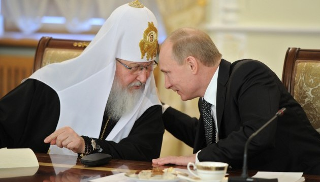 Putin with Kirill, the head of the Moscow Patriarchate of the Russian Orthodox Church (Image: Ukrinform.ru)