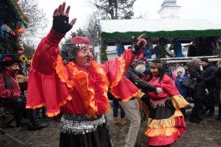 Masked men dance as gypsy women