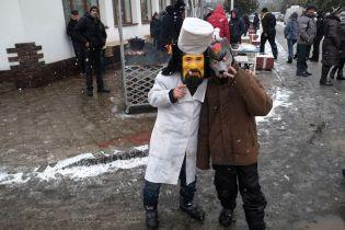 Children wear masks of animals on the streets of Vashkivtsi
